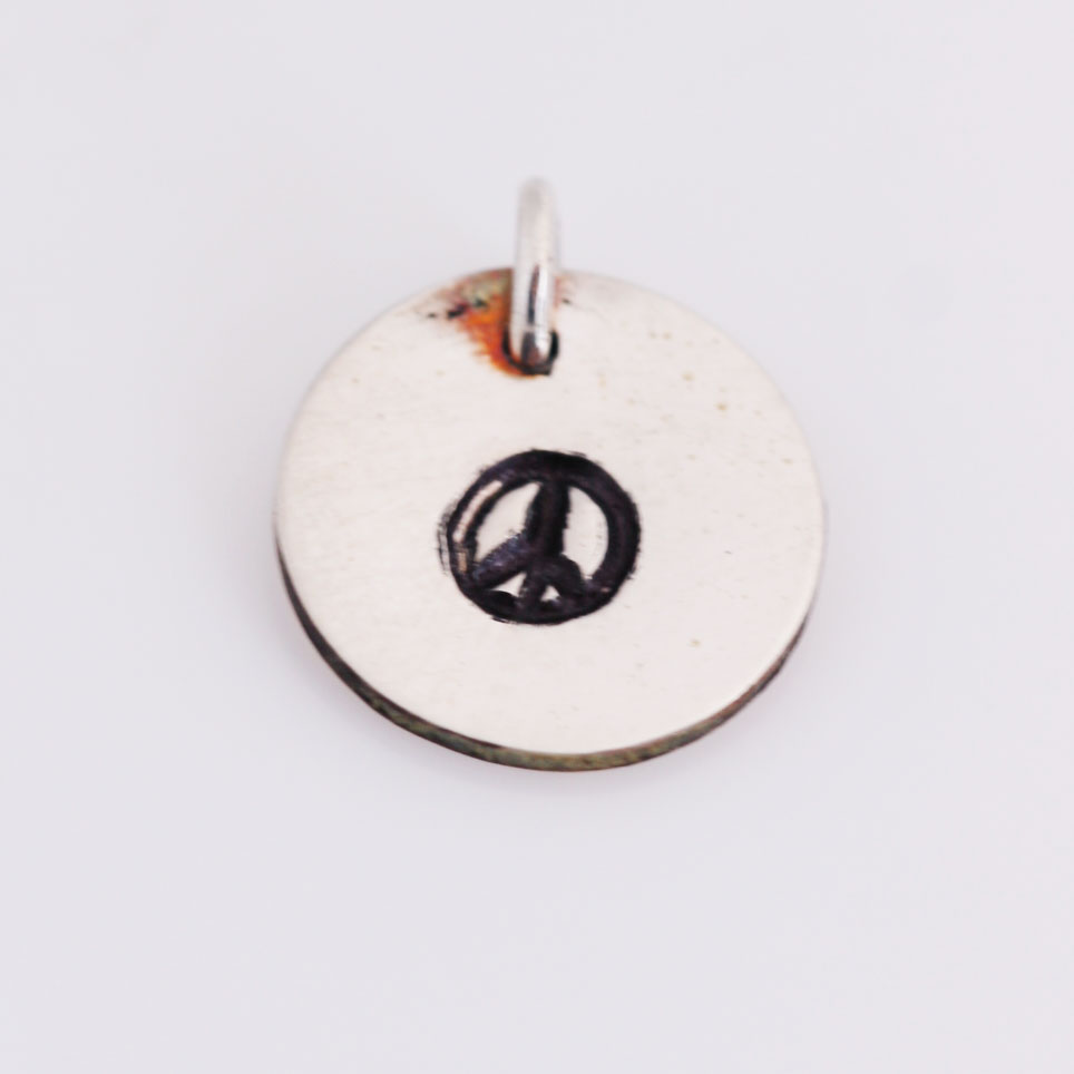 Peace-sign stamped charm